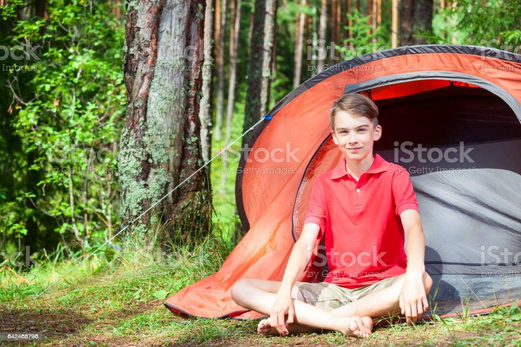 Boy enjoying summer in a camping stock photo