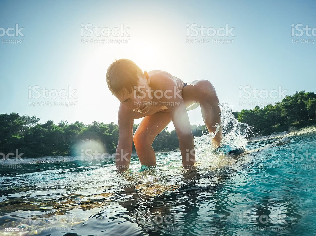 Boy enjoys sea stock photo