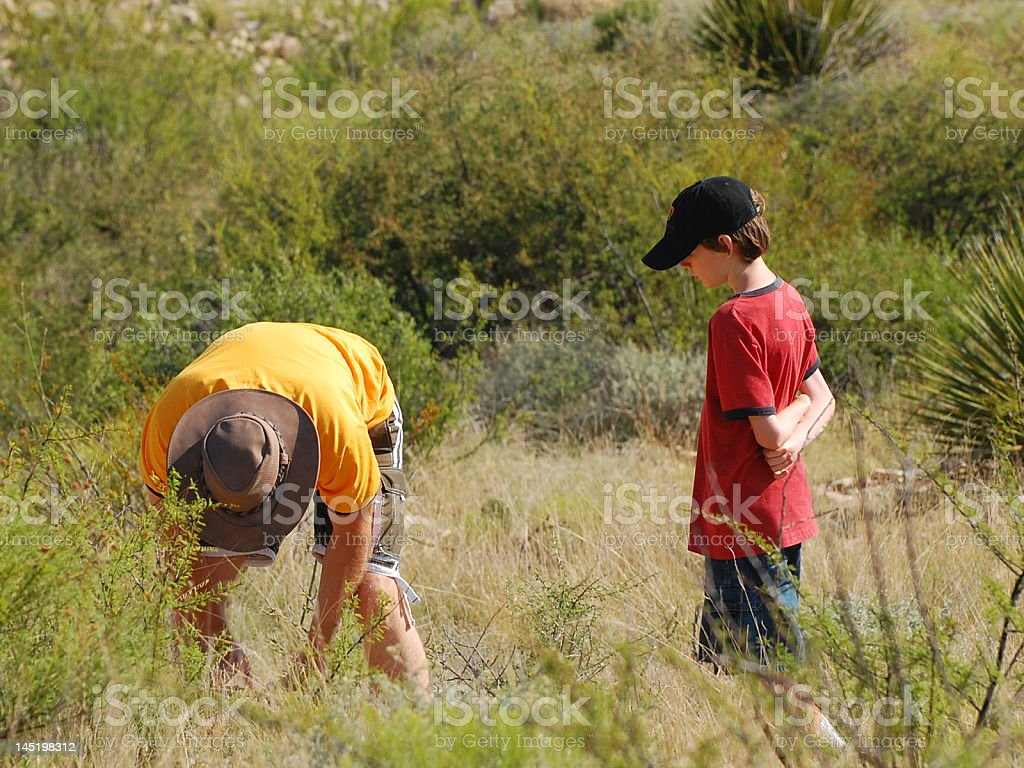 Boy Explores With His Father royalty-free stock photo