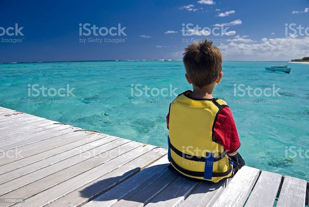 Boy facing Lagoon royalty-free stock photo