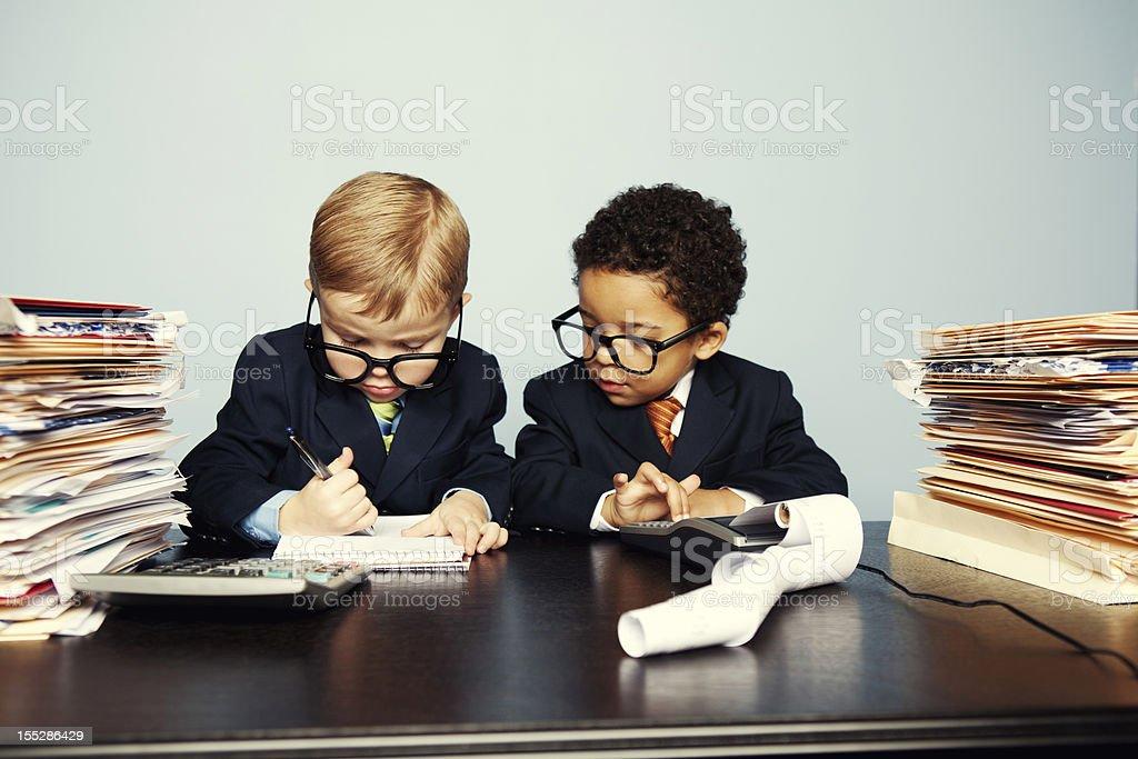 Boy Financial Advisors Add Numbers on Calculator stock photo