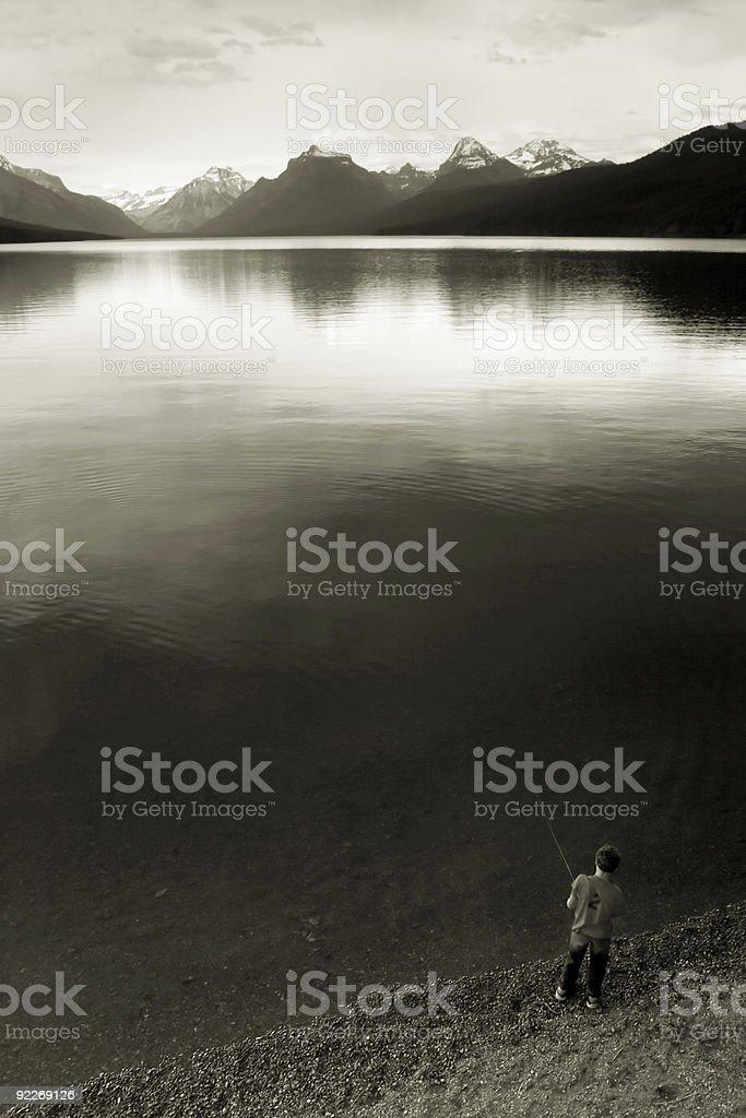 Boy Fishing, Lake McDonald stock photo