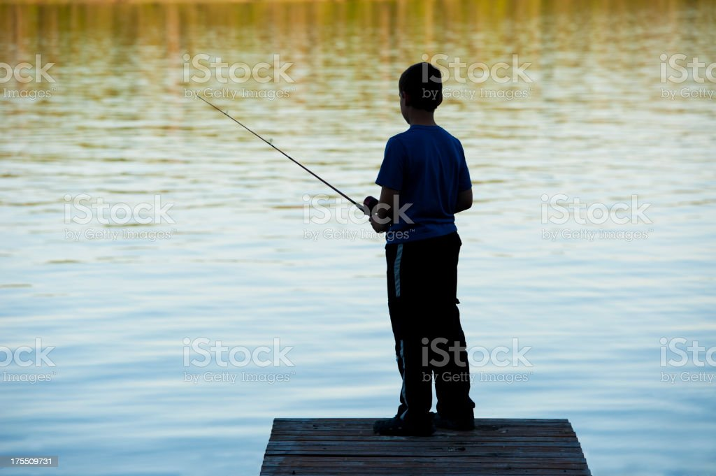 Boy Fishing Silhouette stock photo