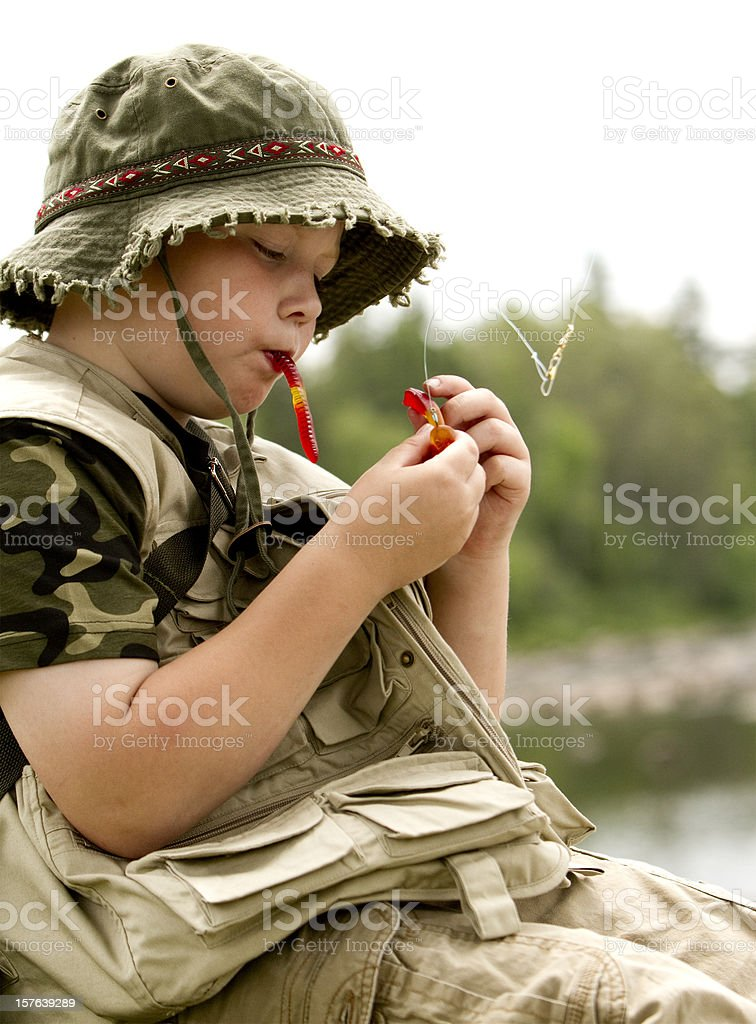 boy fishing with candy worm royalty-free stock photo