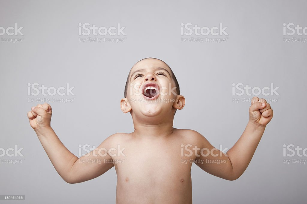 Boy flexing muscles royalty-free stock photo