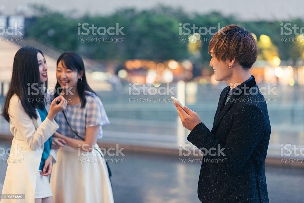 Boy flirting with girls outside stock photo