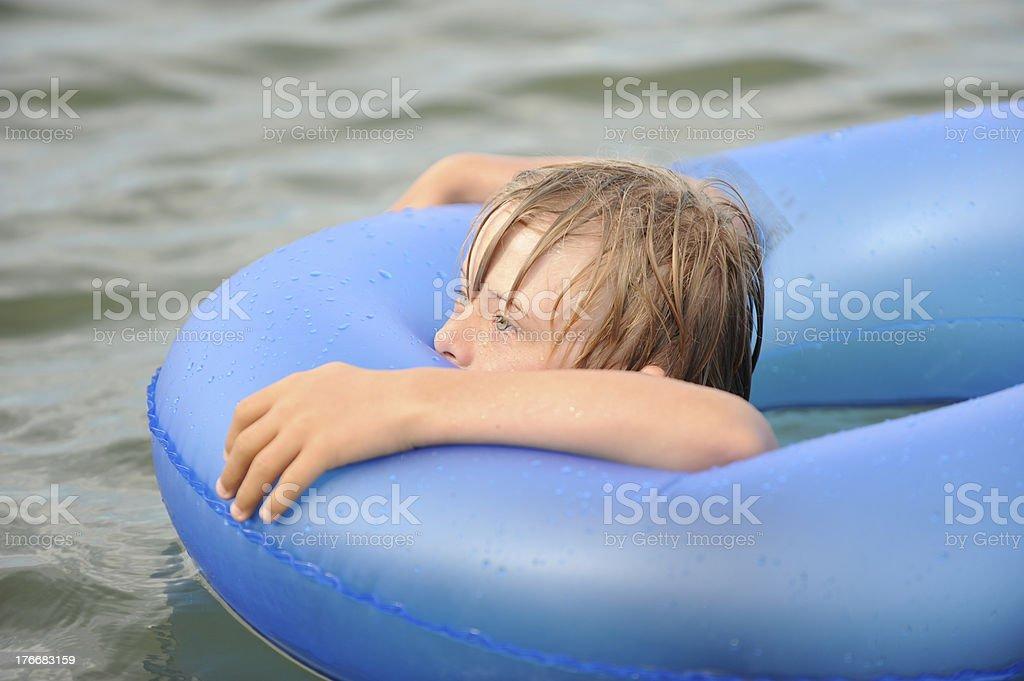 Boy floating royalty-free stock photo