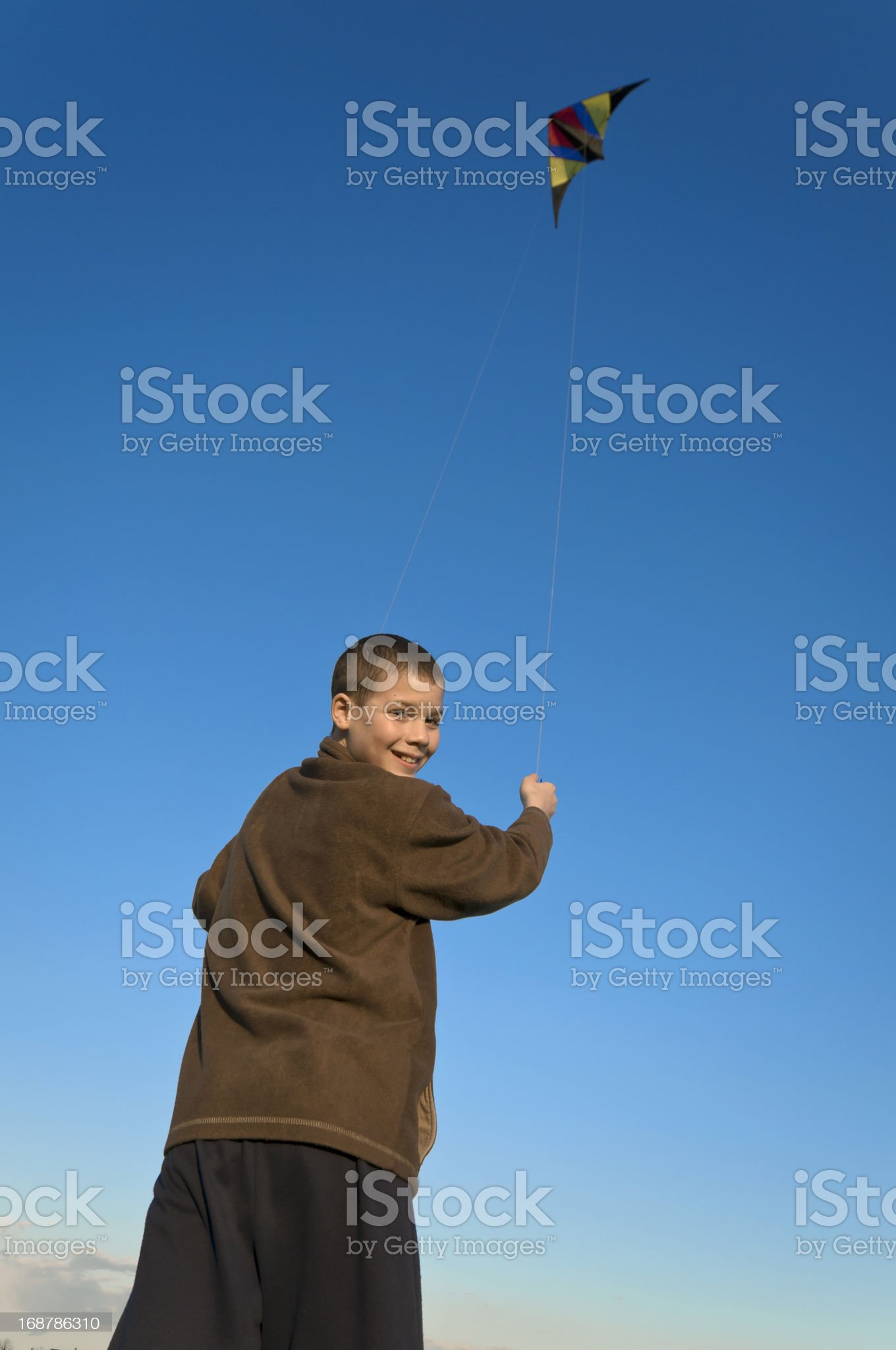 Boy flying a kite face far royalty-free stock photo