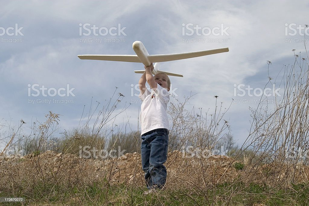 Boy flying airplane royalty-free stock photo