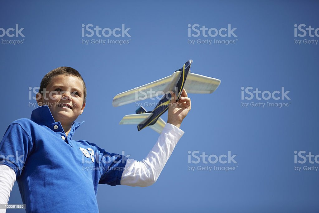 Boy flying toy airplane outdoors royalty-free stock photo