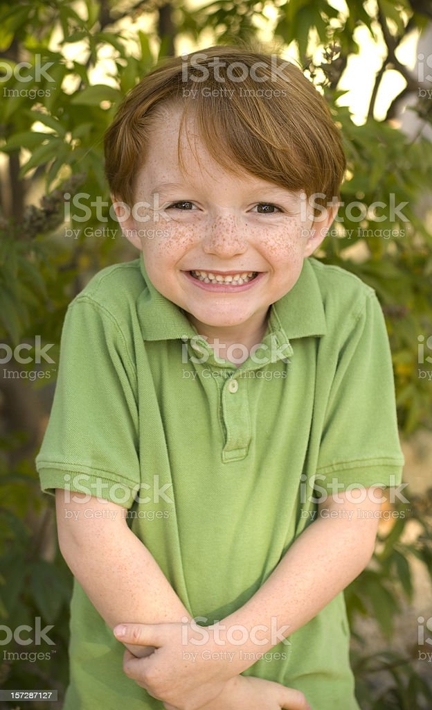 Boy Freckle Face Redhead in Polo Shirt, Happy Smiling Child royalty-free stock photo