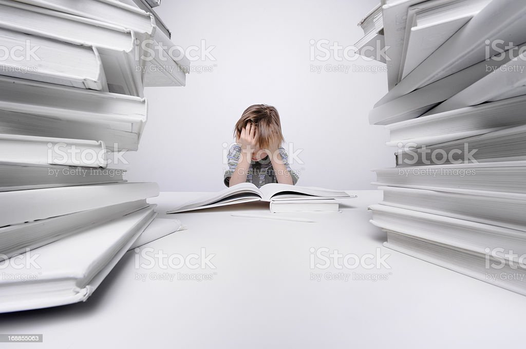 Boy frustrated with homework. stock photo