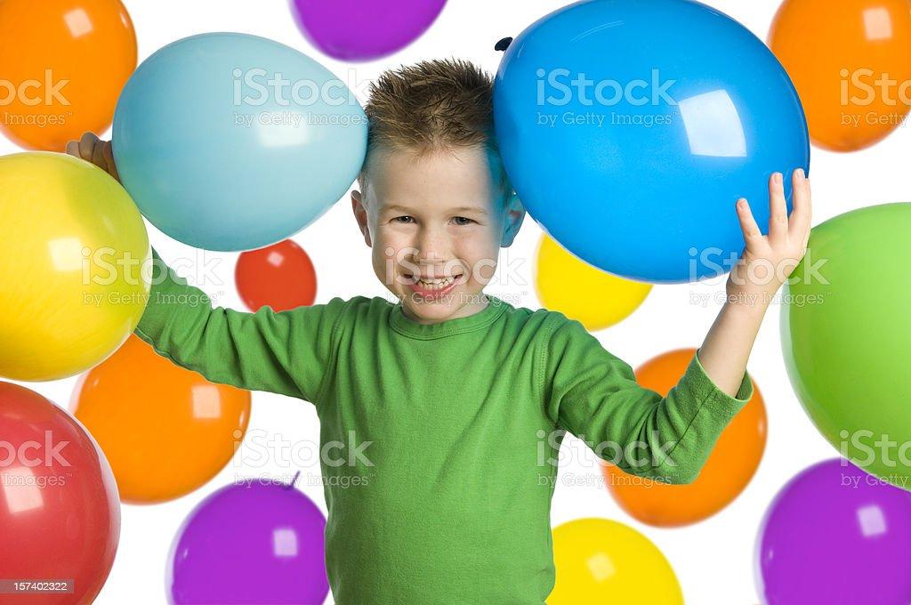 Boy fun with coloured balloons royalty-free stock photo