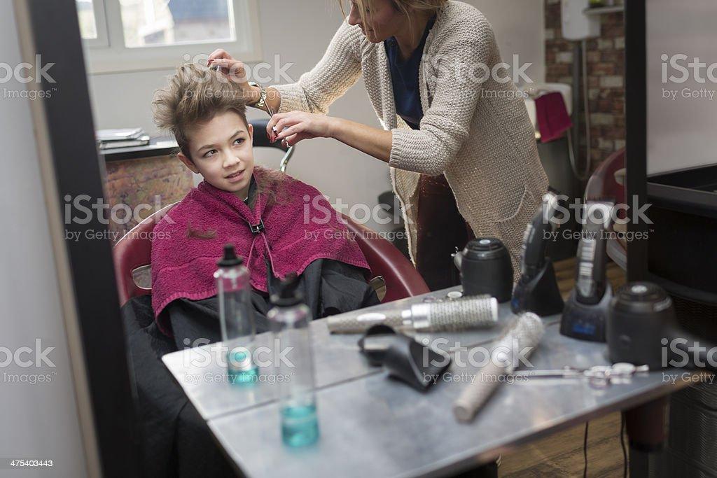 Boy getting a haircut royalty-free stock photo
