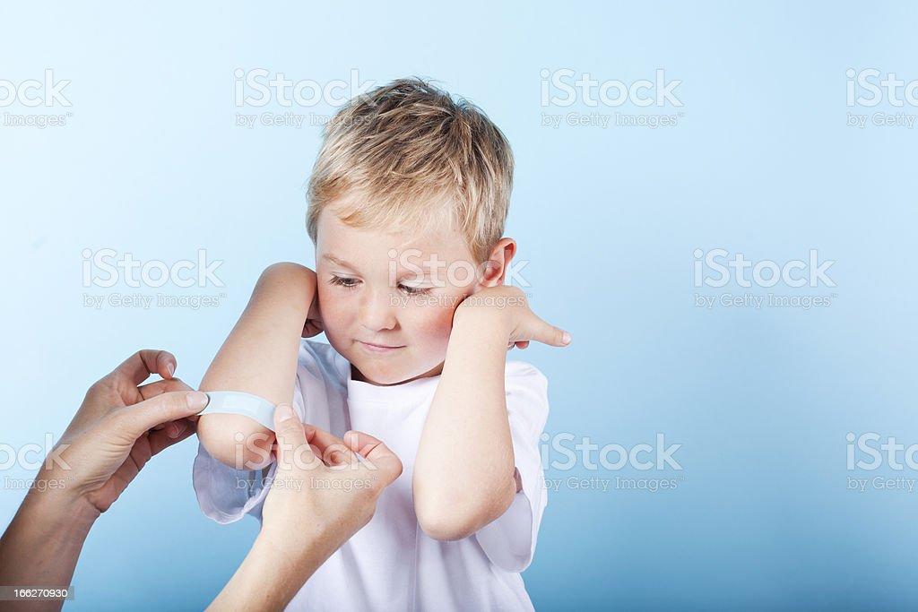 Boy Getting Band-aid stock photo
