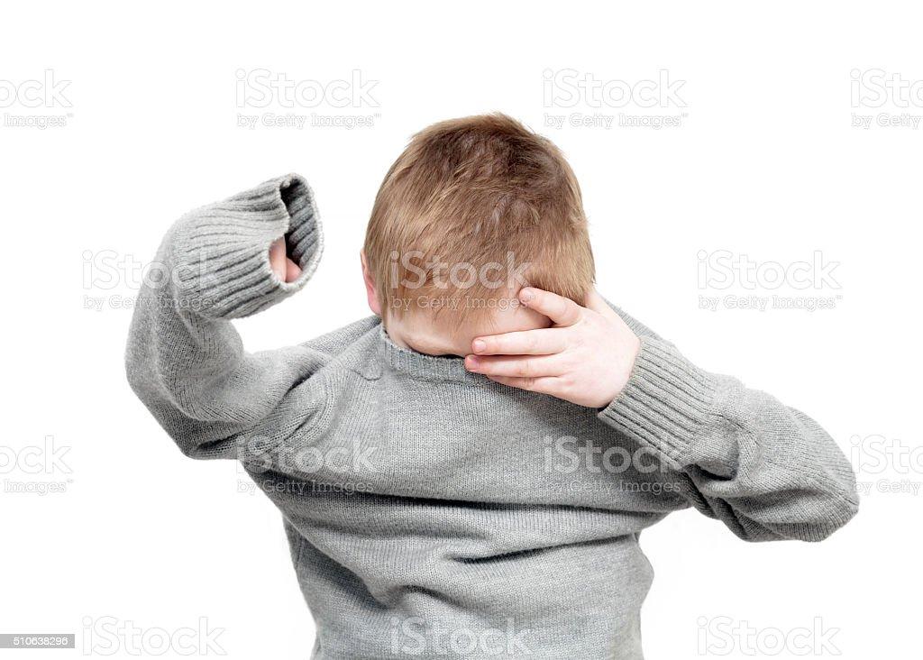 Boy Getting Dressed stock photo