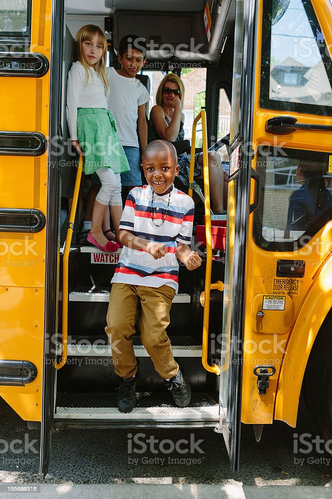 boy getting off school bus royalty-free stock photo