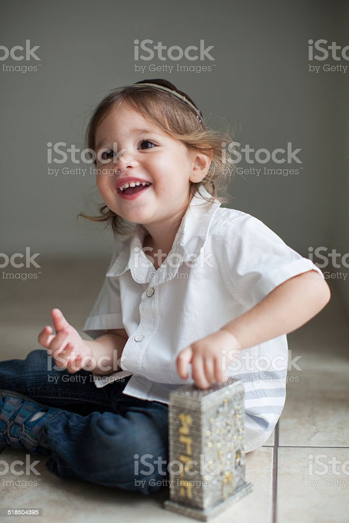 Boy Giving Tzedakah stock photo