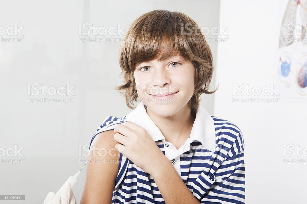 Boy Going Under Vaccination royalty-free stock photo