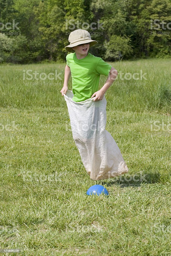 Boy Gunny Sack Race, Elementary School Field Day Looking Back stock photo