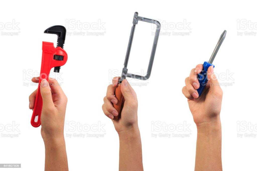 Boy hand holding engineer tool toy. stock photo