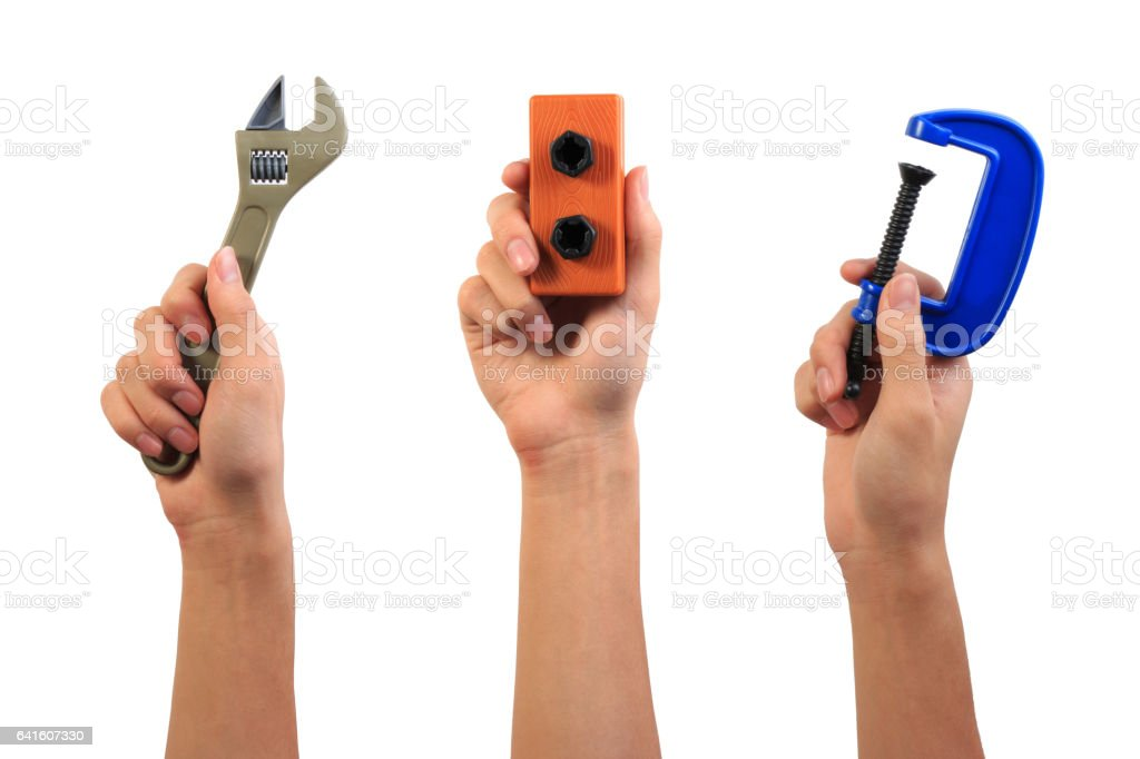 Boy hand holding engineer tool toy. stock photo