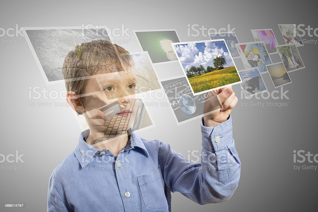 Boy hand reaching images streaming from the deep. stock photo