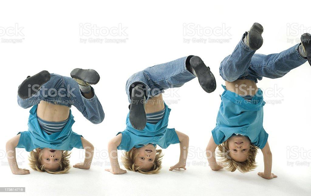 Boy Handstand stock photo