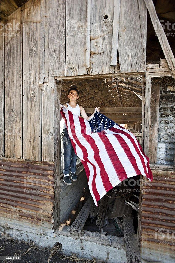Boy hanging American flag royalty-free stock photo