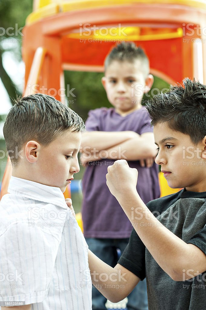 boy harrassed by two bullies royalty-free stock photo