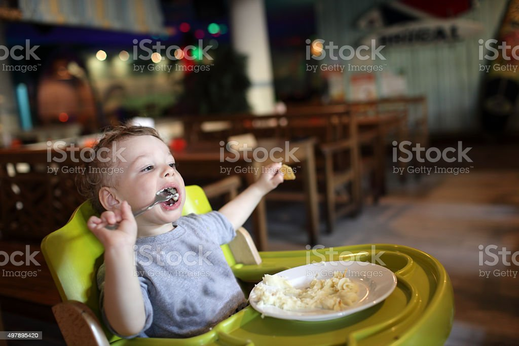 Boy has a lunch stock photo