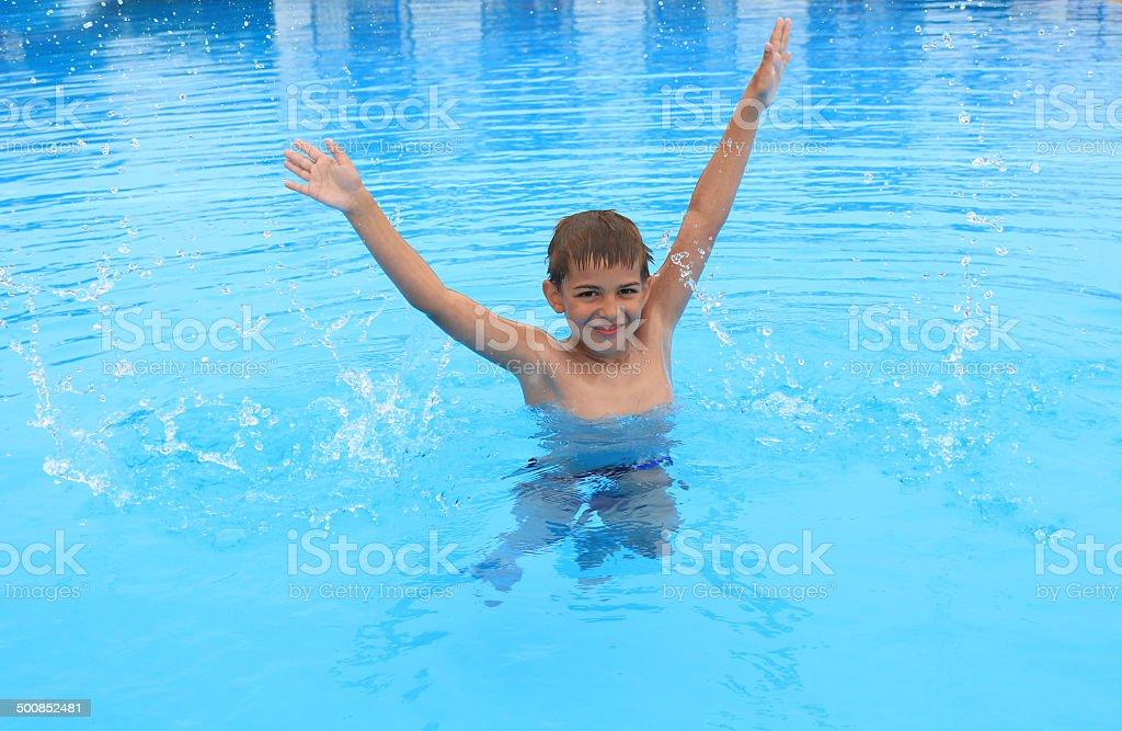 Boy having fun in pool stock photo