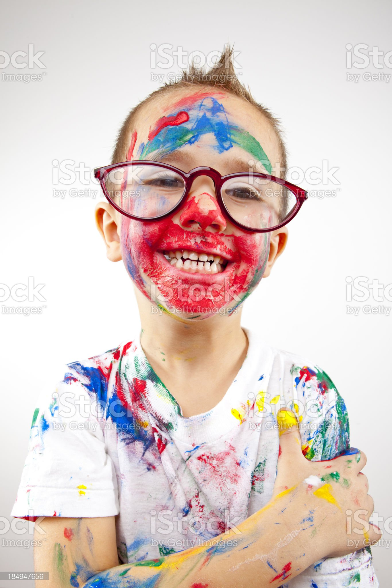Boy having fun with finger paint royalty-free stock photo