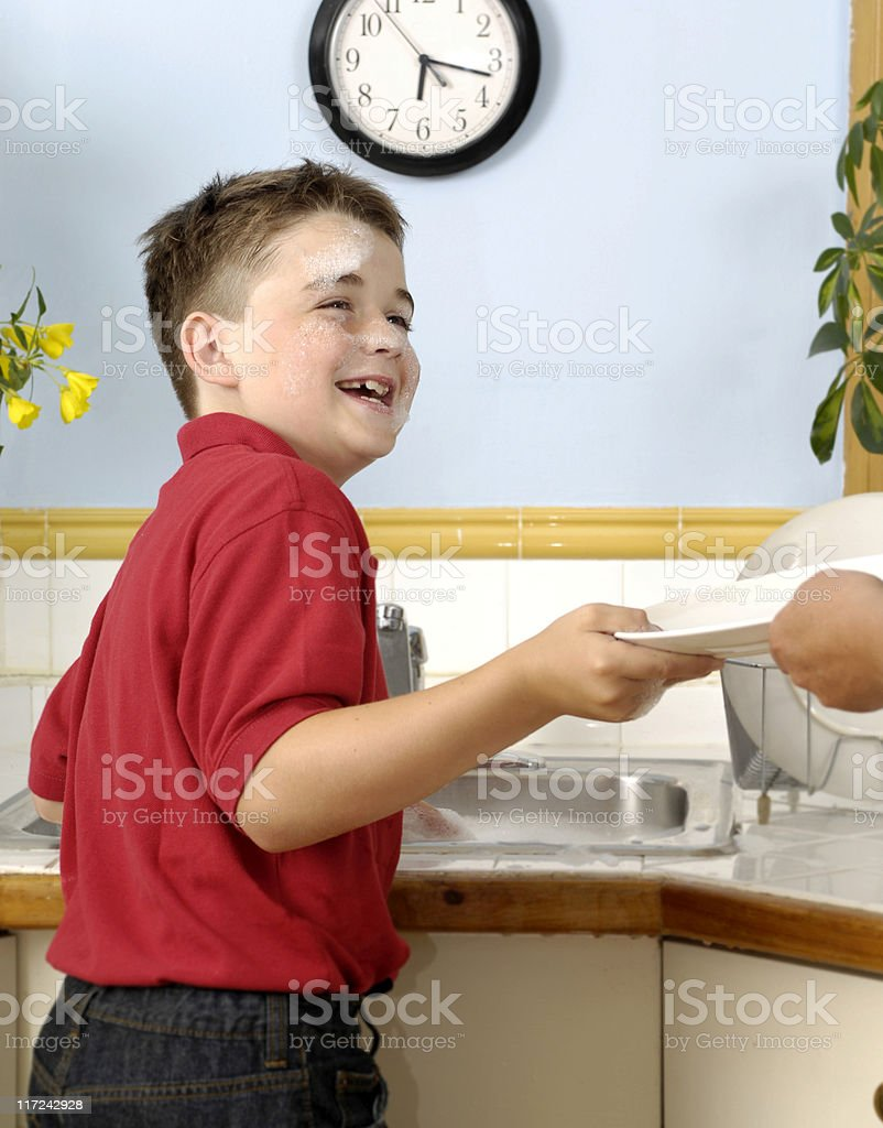 Boy having fun with his chores royalty-free stock photo