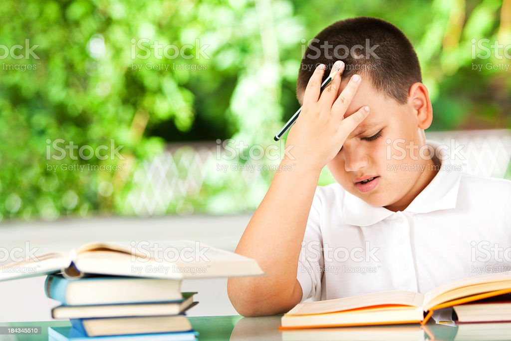 Boy Having Problems With His Homework stock photo