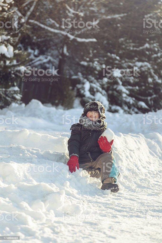Boy having snowball fight royalty-free stock photo