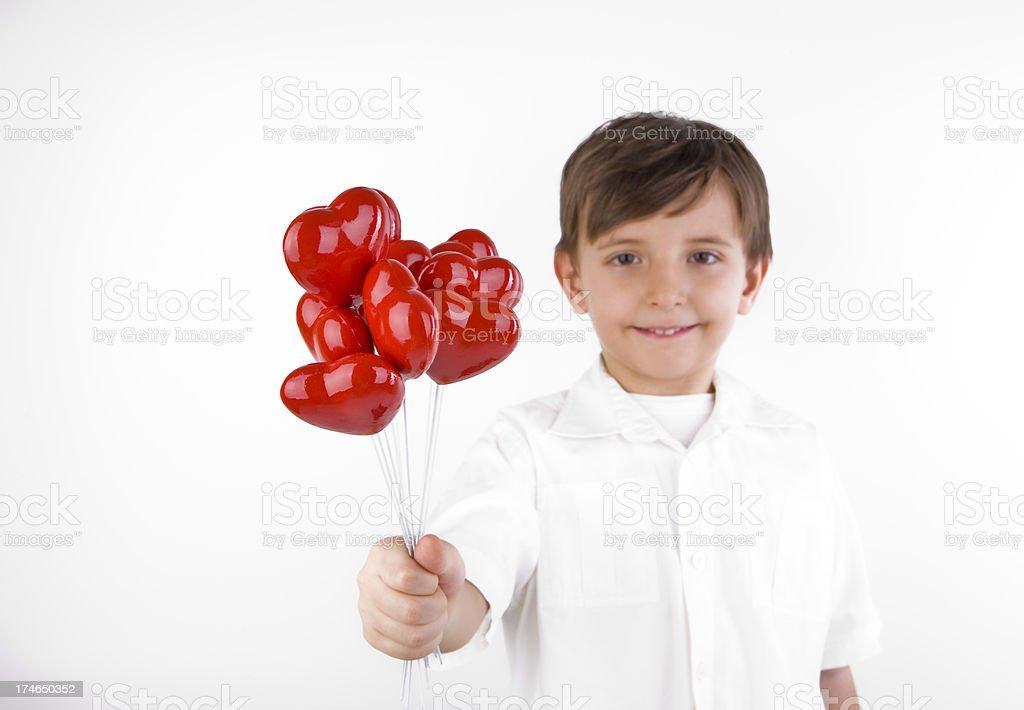 Boy Hearts Giving stock photo