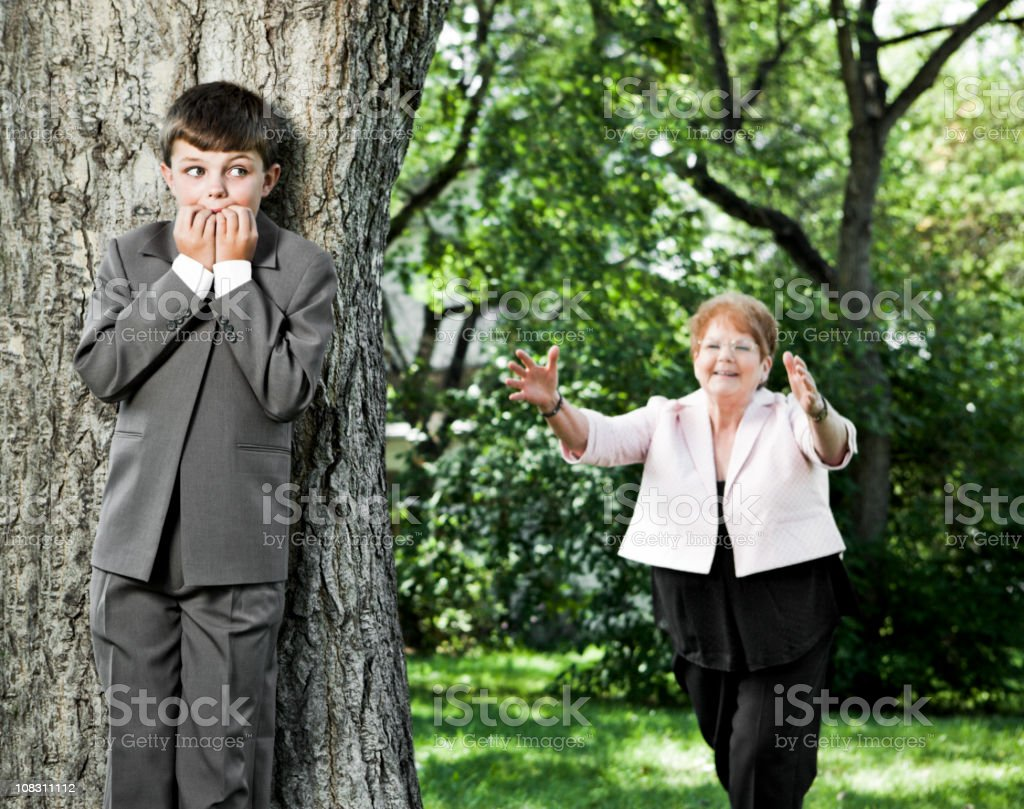 Boy Hides from Grandmother royalty-free stock photo