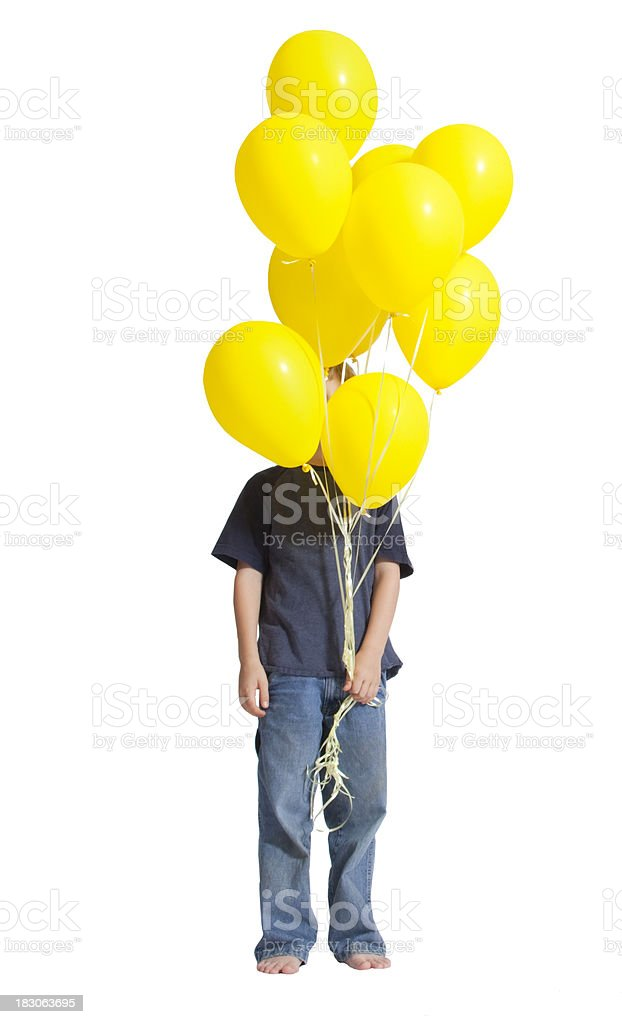 Boy hiding behind a bunch of yellow balloons in his hand royalty-free stock photo