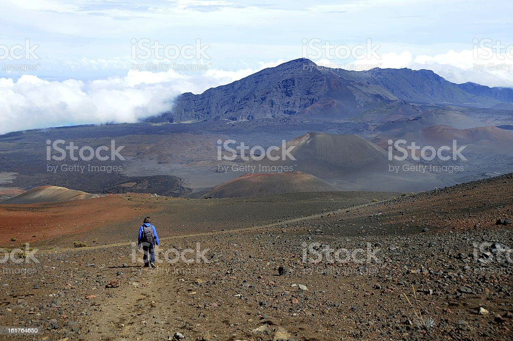 Boy hiking Haleakala Volcano in Maui Hawaii. royalty-free stock photo