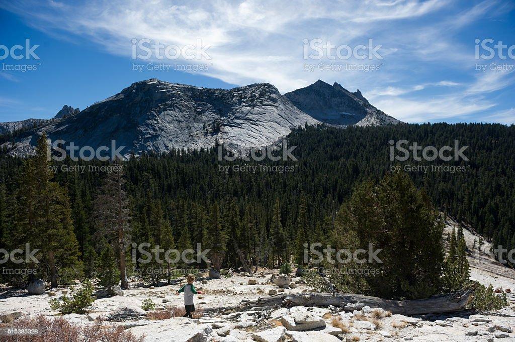 Boy hiking in Yosemite National Park stock photo