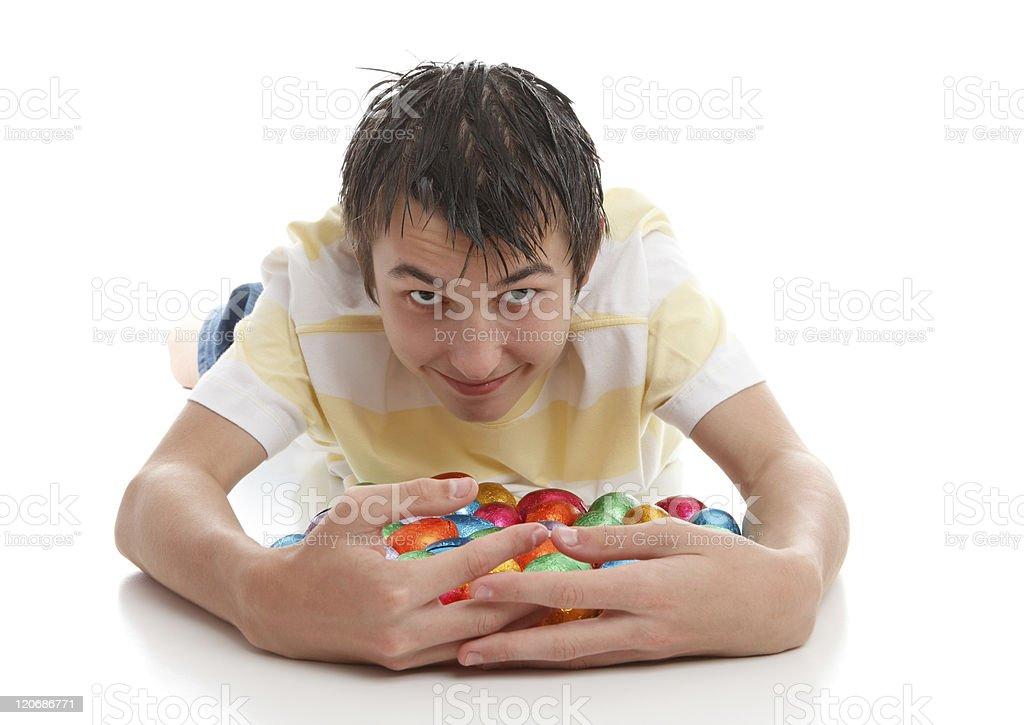 Boy hoarding easter eggs royalty-free stock photo