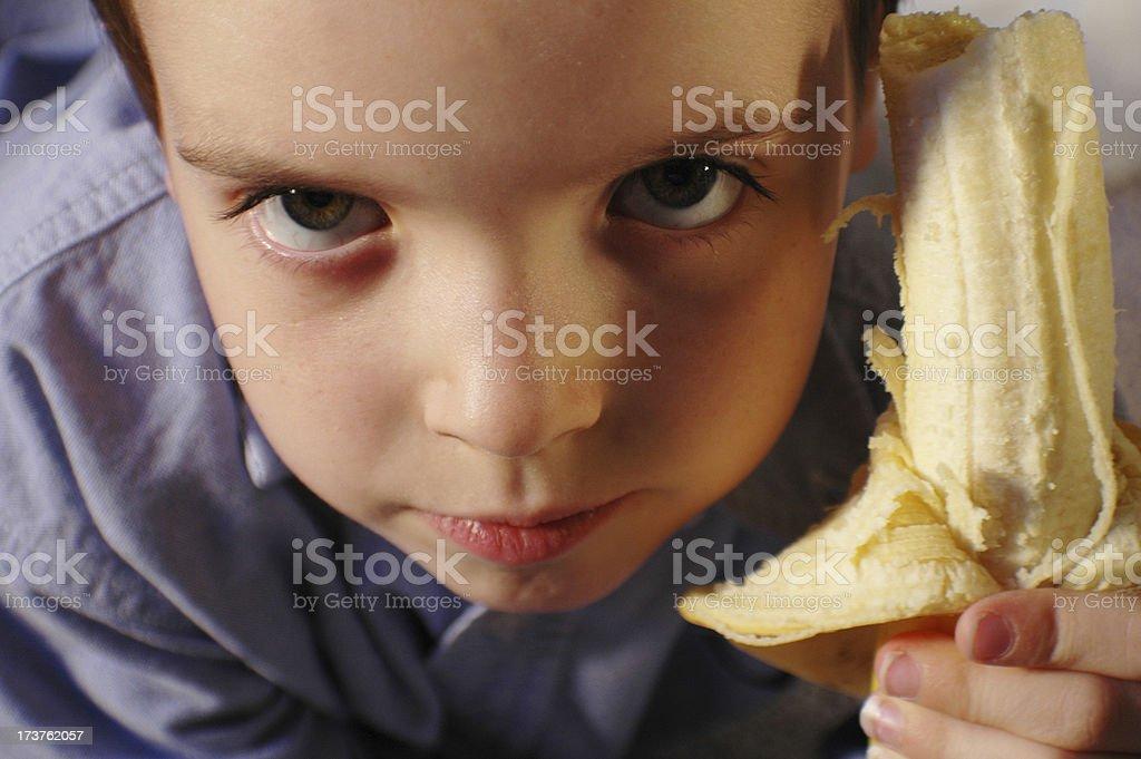 Boy holding a banana stock photo