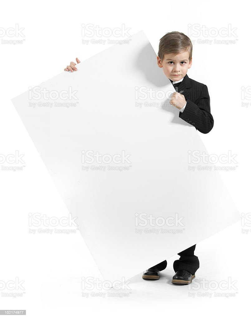 Boy holding a banner royalty-free stock photo
