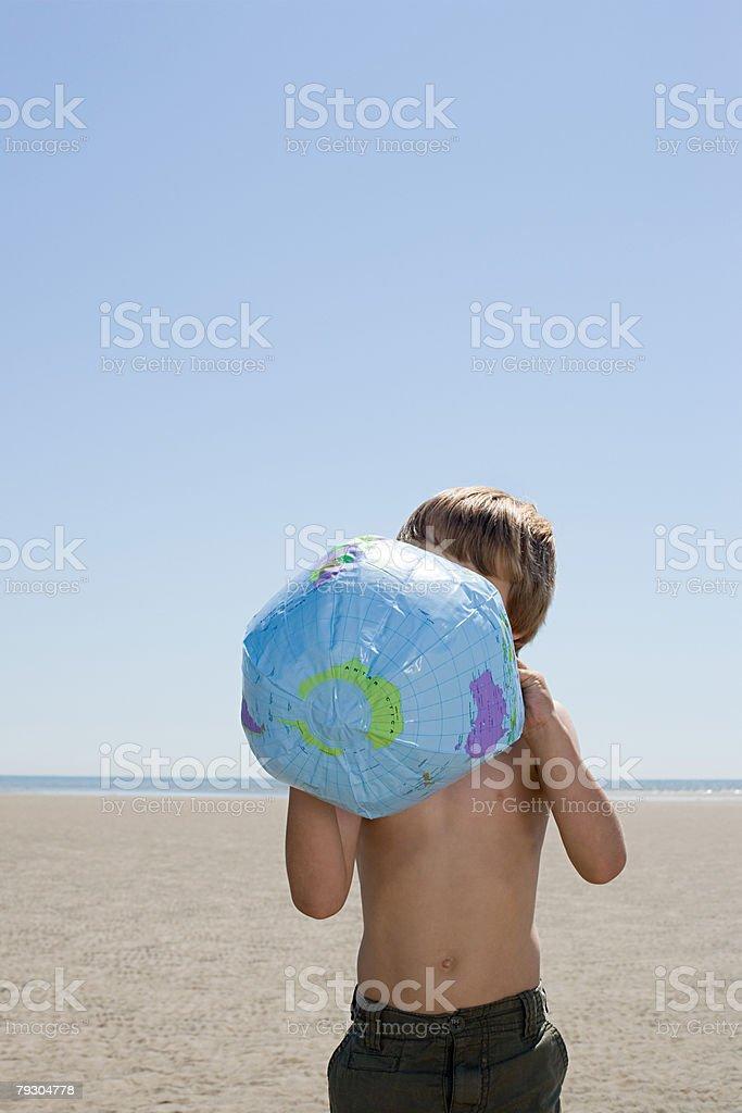 Boy holding a beach ball royalty-free stock photo