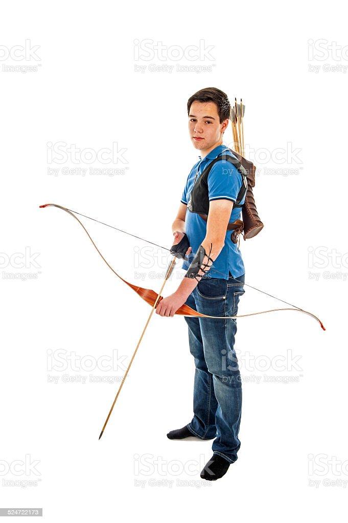 Boy holding a bow an arrow stock photo
