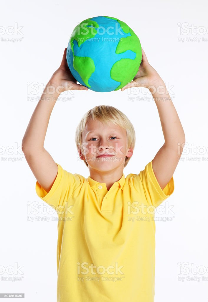Boy Holding a Clay Globe on White stock photo