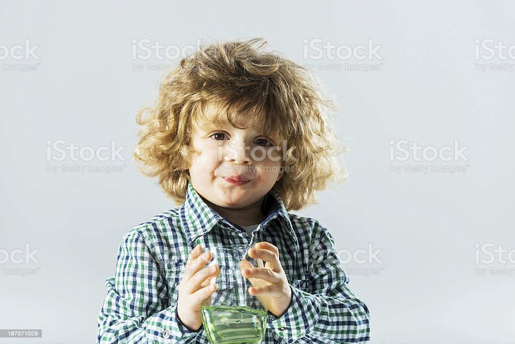 Boy holding a glass of water. royalty-free stock photo