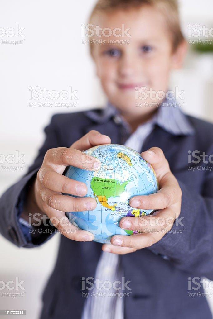 Boy holding a globe royalty-free stock photo