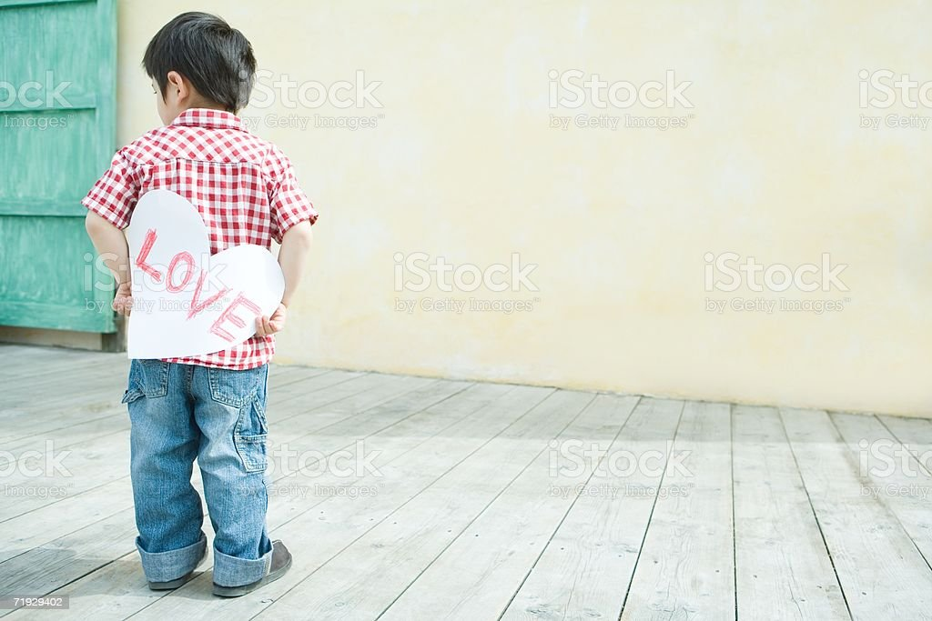 Boy holding a love heart stock photo